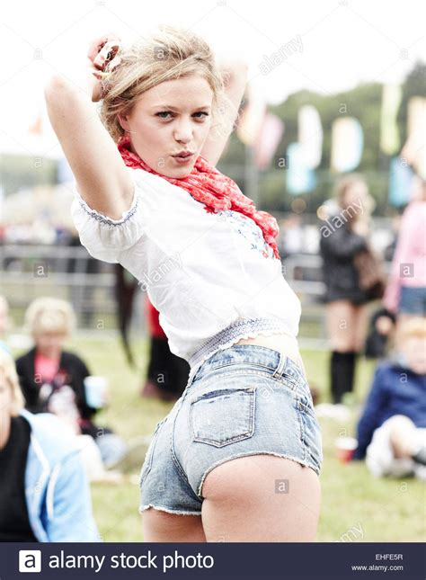 Hot girl in denim shorts at Bestival on the Isle of Wight